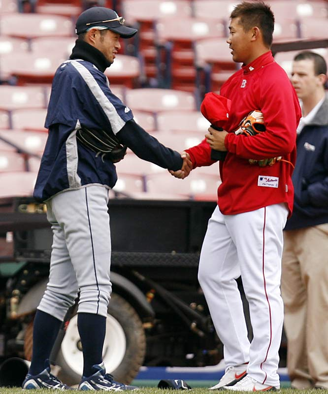 Ichiro Suzuki and Daisuke Matsuzaka greet each other prior to the Mariners-Red Sox game on Tuesday.