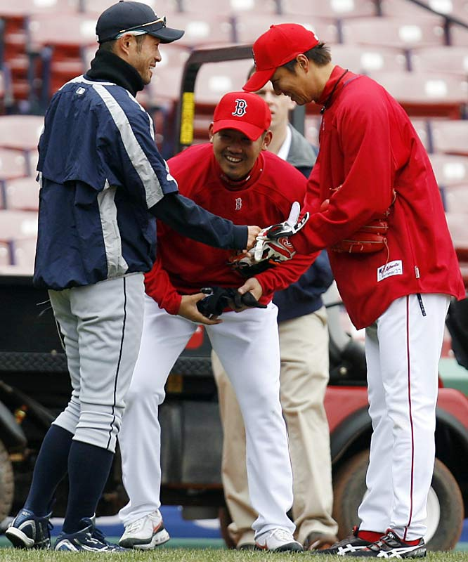 Red Sox reliever Hideki Okajima bows to Ichiro as the two share a laugh with Matsuzaka.