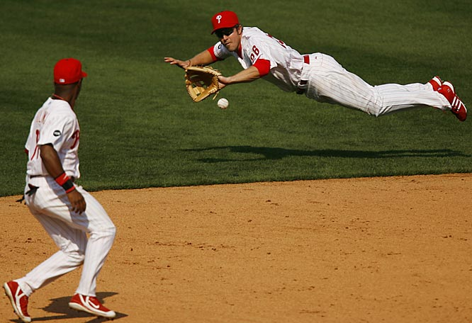 Phillies second baseman Chase Utley dives for a ground ball.
