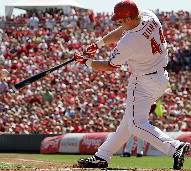 The Reds' Adam Dunn hits his first of two home runs in the game, a two-run shot in the first inning.