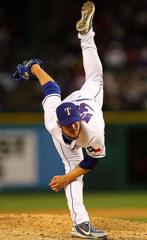 Rangers' reliever C.J. Wilson kicks his left leg up on his follow-through of a pitch against the Red Sox on Sunday.
