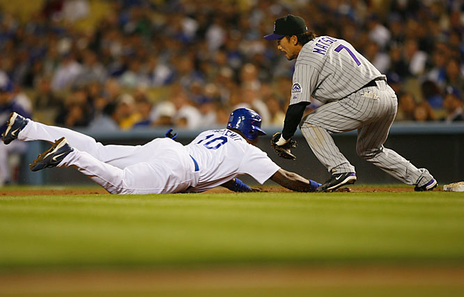 Wilson Betemit is picked off at first by Rockies' second baseman Kazuo Matsui, covering for first baseman Todd Helton, in the third inning of a 2-1 win for the Dodgers on April 10.