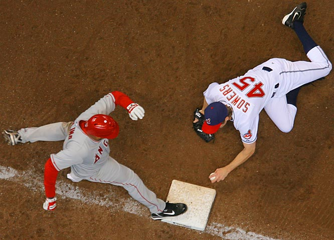 Indians' pitcher Jeremy Sowers beats the Angels' José Molina to the bag for an out at first.  Cleveland won 4-2.