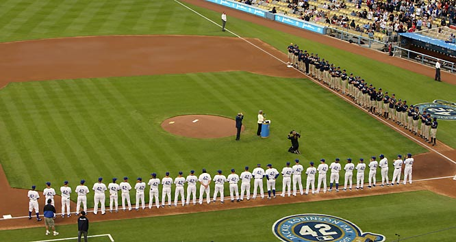 The Dodgers and Padres listen to Rachel Robinson after she received an historic achievement award from Commissioner Bud Selig during pre-game ceremonies honoring #42,  Jackie Robinson, at Dodgers Stadium on Sunday.