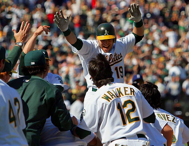 The A's Marco Scutaro celebrates with teammates after hitting a three-run walk-off homer off Yankees reliever Mariano Rivera in the bottom of the ninth on Sunday.  Oakland won 5-4.