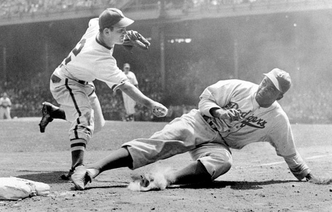 Robinson is tagged out by Phillies third baseman Ralph Caballero on May 2, 1948, at Philadelphia's Shibe Park.
