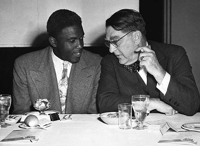 The architect of the Brooklyn Dodgers dynasty, Branch Rickey, chats with Robinson at the Chicago Baseball Writers' Association annual dinner on Jan. 18, 1948.
