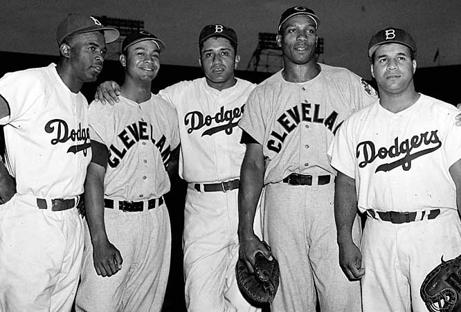 Robinson poses with other black stars from his era, (from left) Larry Doby, Don Newcombe, Luke Easter and Roy Campanella. Doby was the first black player in American League history.