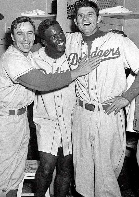Reese, Robinson and Preacher Roe celebrate the Dodgers' 5-3 victory in Game 3 of the 1952 World Series at Yankee Stadium. The Yankees would win the Series in seven games.