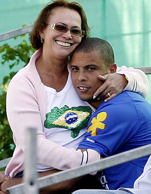 Brazilian striker Ronaldo Nazario gets a hug from his mother, Sonia, after a training session in Germany before the 2006 World Cup.