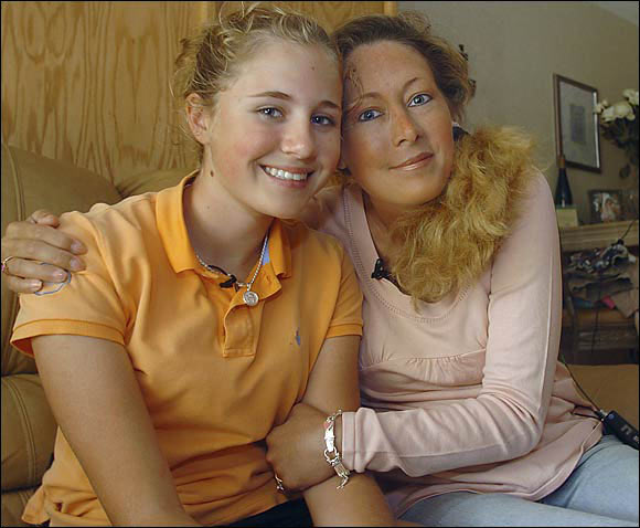 Dakoda Dowd sits with her mother, Kelly Jo Dowd, in their apartment in Palm Harbor, Fla. Dakoda was given an exemption to play in the 2006 LPGA Ginn Open in Orlando so that Kelly Jo, who has terminal cancer, could fulfill her wish of seeing her 13-year-old daughter play against the best women golfers in the world.