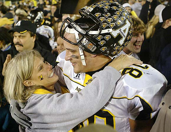 Appalachian State's Daniel Bettis embraces his mother, Teresa, after the Mountaineers won the Division 1-AA championship with a 28-17 victory over UMass.