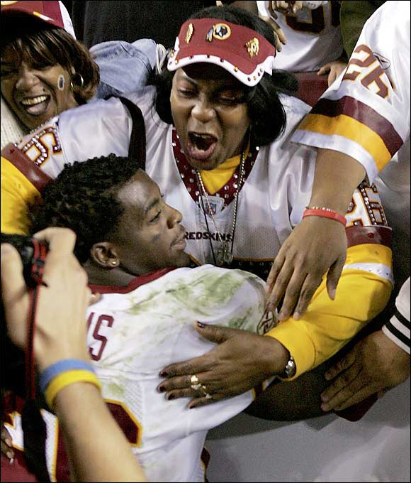 NFL running back Clinton Portis celebrates with his mother, Rhonnel Hearn, after Washington beat Philadelphia 17-10. Portis famously took his mother to his senior prom at Gainesville (Fla.) High in 1999.
