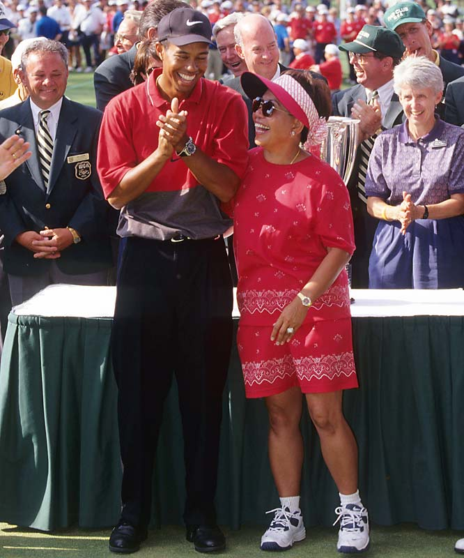 Tiger Woods shares a laugh with his mother, Katilda, during a November 2003 tournament.