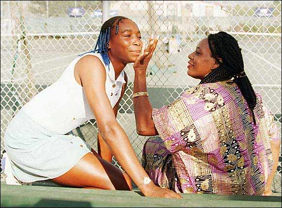 In her first year as a pro, at age 15, tennis prodigy Venus Williams gets her face wiped by her mother, Oracene Williams, before conducting a tennis clinic for inner-city youth in Oakland.