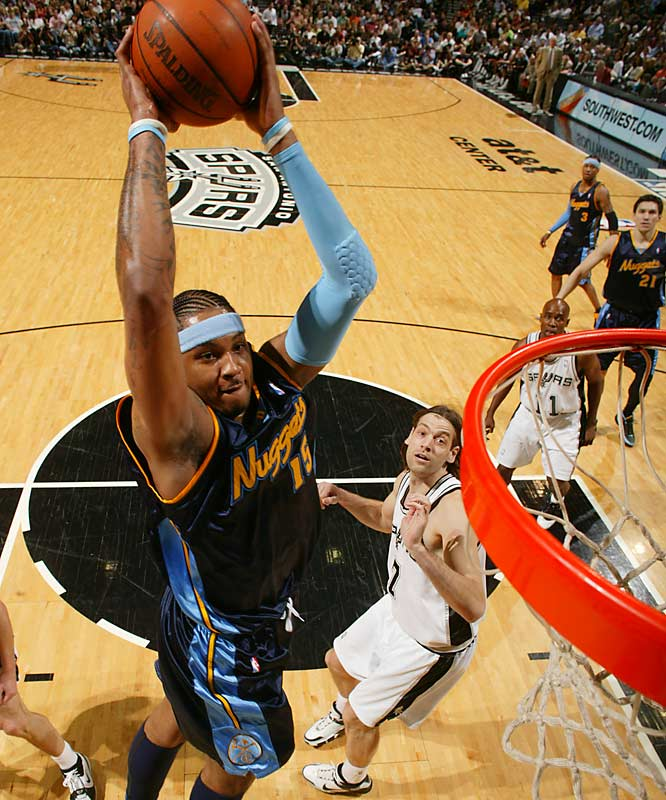 Carmelo Anthony scored 30 points as the Nuggets got off to a successful start at San Antonio in their bid to win a playoff series for the first time since 1994.