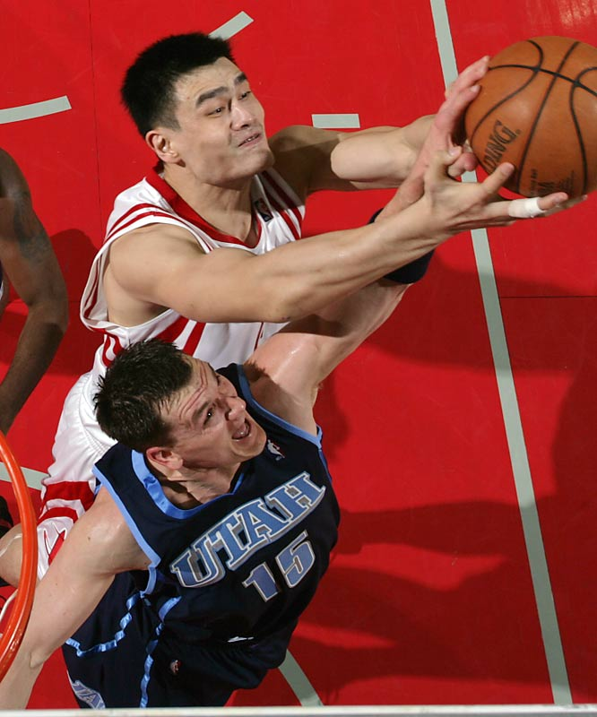 Yao Ming, battling Matt Harpring here for a loose ball, led the Rockets with 28 points and 13 rebounds.