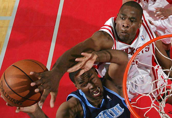 Dikembe Mutombo blocks Jarron Collins' shot on a night when the Rockets limited the Jazz to 35.6 percent shooting from the field.