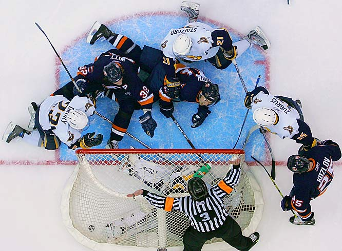Two nights after a questionable review went against the Islanders, resulting in a Sabres goal, referee Mike Leggo waved off a goal by Isles defenseman Brendan Witt with 1:42 left in the third period, ruling Sabres' goalie Ryan Miller was pushed into the net after making the save.