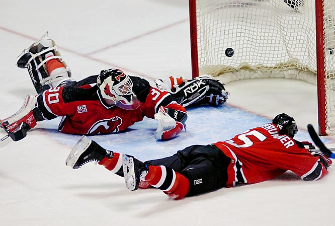 Devils goalie Martin Brodeur and Jamie Langenbrunner can only watch as the puck goes in for a Lightning goal by Filip Kuba in the first period.