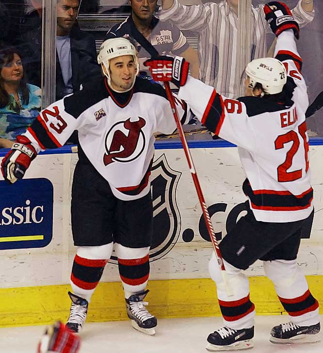 Longtime teammates Scott Gomez and Patrik Elias celebrate Gomez's game-winning overtime goal that evened the series 2-2.