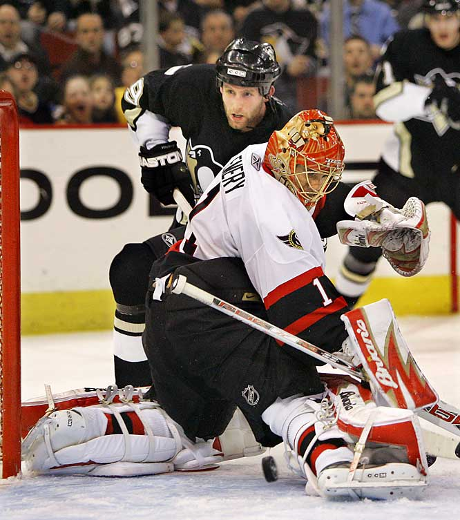Pens' defenseman Ryan Whitney gets a shot past Ray Emery but didn't score on the Sens' goalie, who made 23 saves in the game to put Ottawa up 3-1 in the series.
