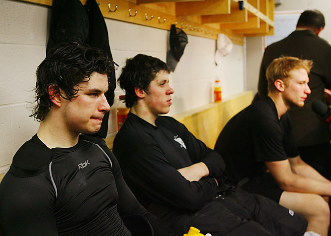 Young stars (left to right) Sidney Crosby, Evgeni Malkin and Jordan Staal sit solemnly in the Penguins locker room after losing their first playoff series.