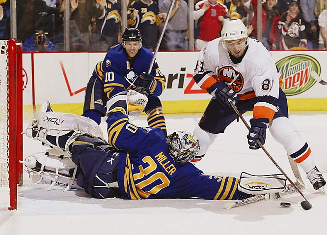 Sabres netminder Ryan Miller brings his glove around as he sprawls across the crease to deflect a shot from Miroslav Satan in the final seconds of the game. Buffalo won the series 4-1 and will play the New York Rangers in the semifinals.