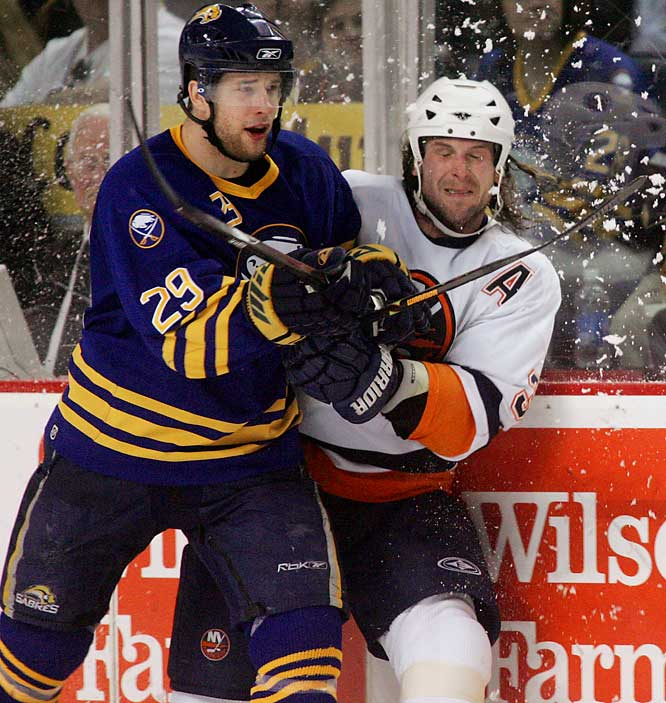 Sabres right wing Jason Pominville checks defenseman Brendan Witt into the boards.  Pominville scored Buffalo's second goal of the game just 39 seconds into the second period.