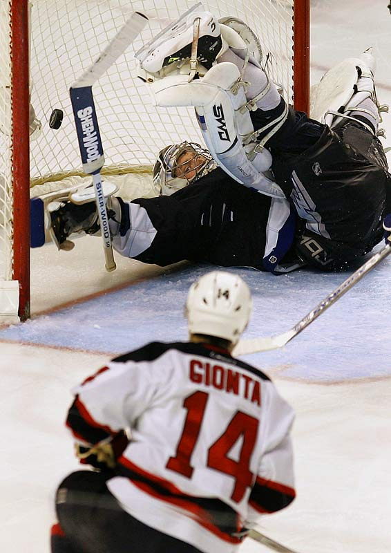 Brian Gionta scores his second goal of the game, and fifth of the series, past Lightning goalie Johan Holmqvist on Sunday.