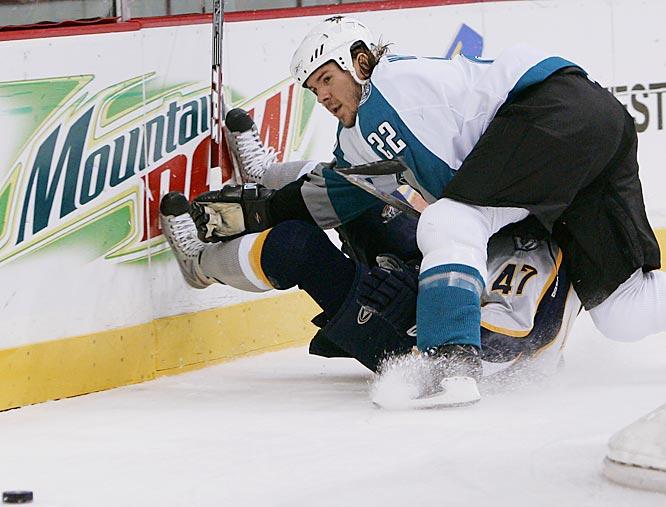 Sharks defenseman Scott Hannan dumps Predators rookie Alexander Radulov to the ice behind the net.