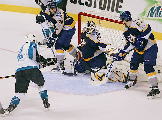 Patrick Marleau scores past Preds' goalie Tomas Vokoun late in the third period to give the Sharks the lead.  Marleau scored twice as San Jose held on to win the game and clinch the series 4-1.
