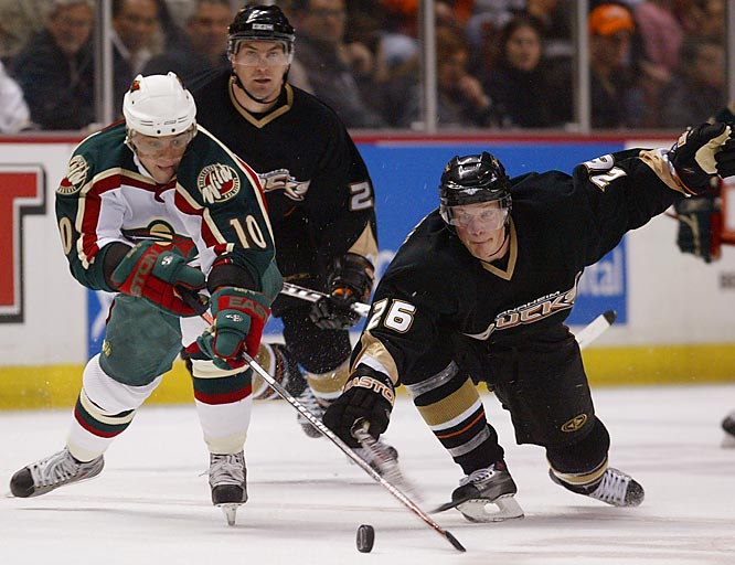 Ducks center Samuel Pahlsson poke checks the puck away from Wild right wing Marian Gaborik.  Minnesota's top goal-scorer, Gaborik led the Wild with four shots but no goals.