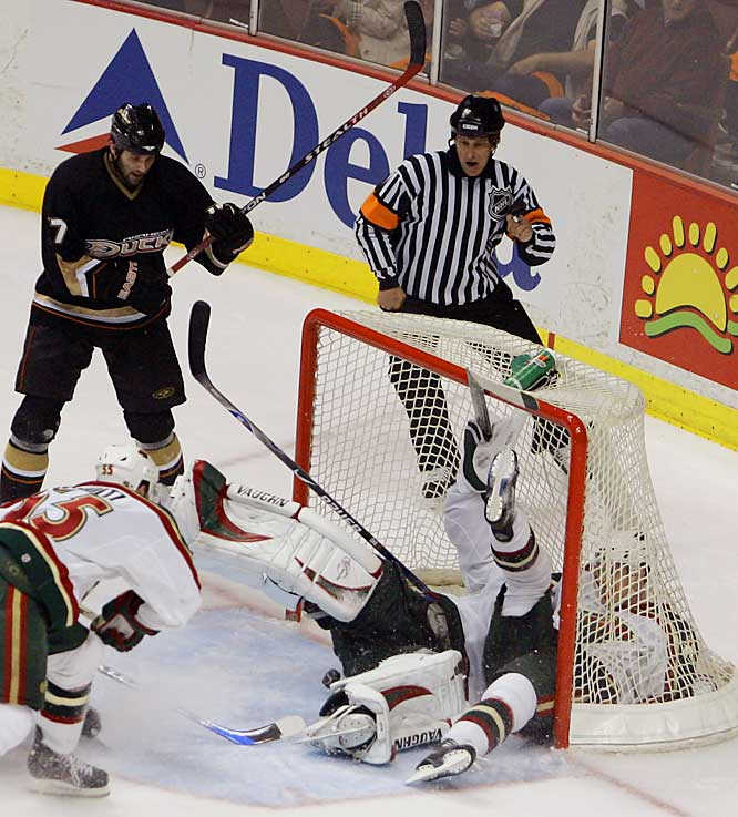 Ducks winger Dustin Penner scores with 5:20 remaining in the third period after Wild defenseman Kim Johnsson crashed into goalie Niklas Backstrom, sending him sprawling into the net.