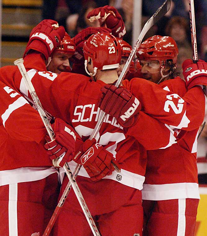 Red Wings defensemen Nicklas Lidstrom, left, and Mathieu Schneider had a lot to celebrate, each scoring a goal and assist, while teammate Henrik Zetterberg, right, played for the first time in nearly two months.