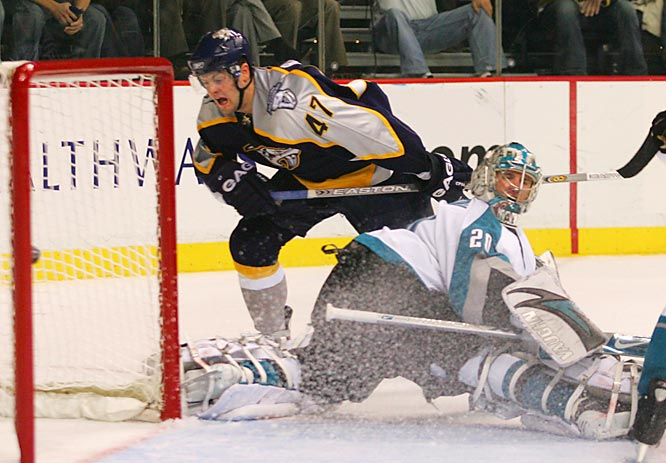 Predators rookie Alexander Radulov scores his second goal of the game past Sharks goalie Evegeni Nabokov.