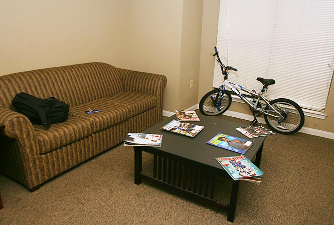 "Plain and simple. That's the way Jean-Francois described his living room. With the latest sports magazines on the table and a spot for his ""means of transportation"" the Miami native said he does not need much else. ""That bike is like my car,"" Jean-Francois said. ""At least it used to be, until my tires ran out of air."""