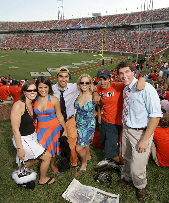 An ongoing debate among UVA fans is how to properly dress for a football game. While some prefer ties and sundresses, others choose a simple T-shirt and baseball cap.