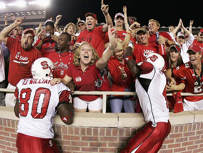 Tight end T.J. Williams (No. 80) and safety J.J. Jones (No. 4) celebrated with fans after a victory over Florida State in November 2005.