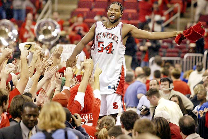 Marcus Melvin (No. 54) celebrated with fans  after the Wolfpack upset top-ranked Duke in February 2004.