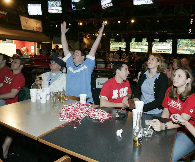 Fans try to enjoy a game at Playmaker's, a popular Raleigh hangout, but are interrupted by UNC fans.