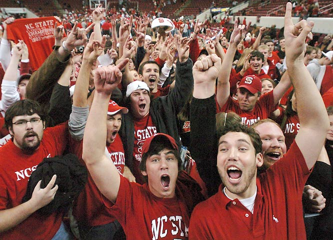 Fans celebrated on the court after the Wolfpack upset then-No. 3 North Carolina last February.