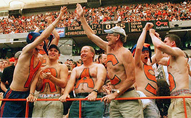 Two generations of Syracuse students enjoy a game. Although we think one of those generations should've left their shirts on.
