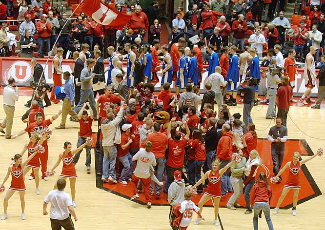 Utah fans swarm the court while the Utah and Air Force players shake hands after a Utes upset.