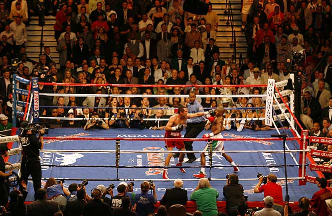 In one of the most lucrative fights in history, Floyd Mayweather Jr. was too talented for Oscar De La Hoya, winning a 12-round split decision in Las Vegas.