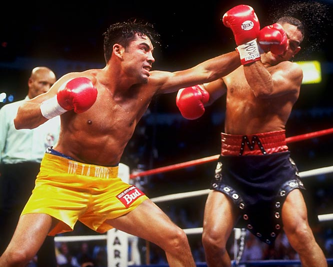 Camacho entered the ring in a black-leather getup complete with visored helmet. He probably should have kept the headgear on, as the self-styled Macho Man was, at 35, past his prime and no match for De La Hoya. Though Camacho was decked in the ninth round, Oscar had to settle for a lopsided decision.  <br><br>Visit SI.com for a live round-by-round of De La Hoya-Mayweather on Saturday.