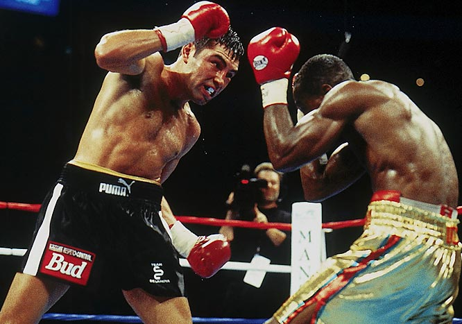 A five-time world champ who had earned more than $75 million in the ring, De La Hoya had yet to be truly tested as a pro. The tough Quartey remedied that -- dropping De La Hoya in the sixth and spearing him with jabs throughout. With the fight on the line in the final round, the Golden Boy proved his mettle, knocking Quartey down and battering him until the closing bell to win a split decision.<br><br>Visit SI.com for a live round-by-round of De La Hoya-Mayweather on Saturday.