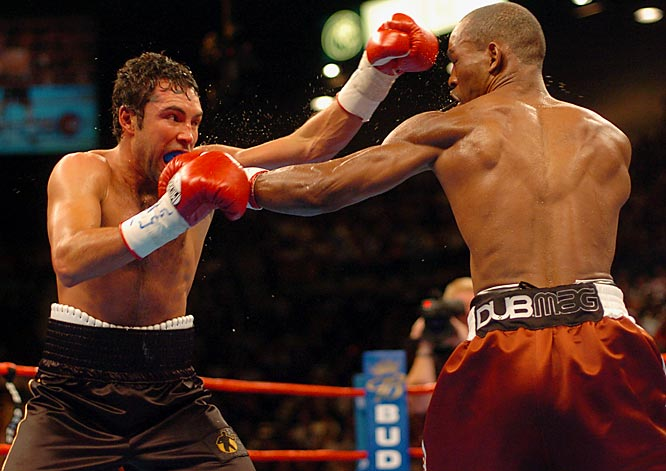 "Call Hopkins the anti-Oscar -- launched not by Olympic success but by a youthful stretch in Pennsylvania's Graterford Prison, driven not by crossover celebrity hype but by a stubborn insistence on doing it his way. Hopkins, at nearly 40, was making the 19th defense of his middleweight title (an earlier one had resulted in a 12th-round TKO of Felix Trinidad). In the end he was simply too big and too strong for De La Hoya, finishing him in the ninth round with a vicious left hook to the body. ""You want to get up,"" said a distraught De La Hoya afterward. ""You just can't.""<br><br>Visit SI.com for a live round-by-round of De La Hoya-Mayweather on Saturday."