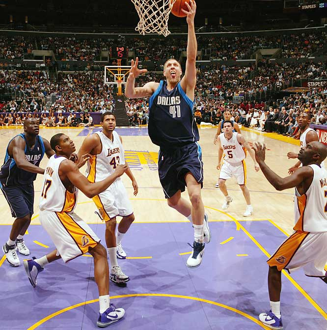 Here's the Dallas Mavericks' Dirk Nowitzki, the 2006-07 regular season NBA MVP, having his way with the Lakers. It looks like he's having a great deal of fun, with his tongue out a la Michael Jordan. He had a great year, though I'm sure he wishes the playoffs had worked out differently.<br><br>Shot with: Canon EOS-1Ds Mark II, 34 1.4 lens