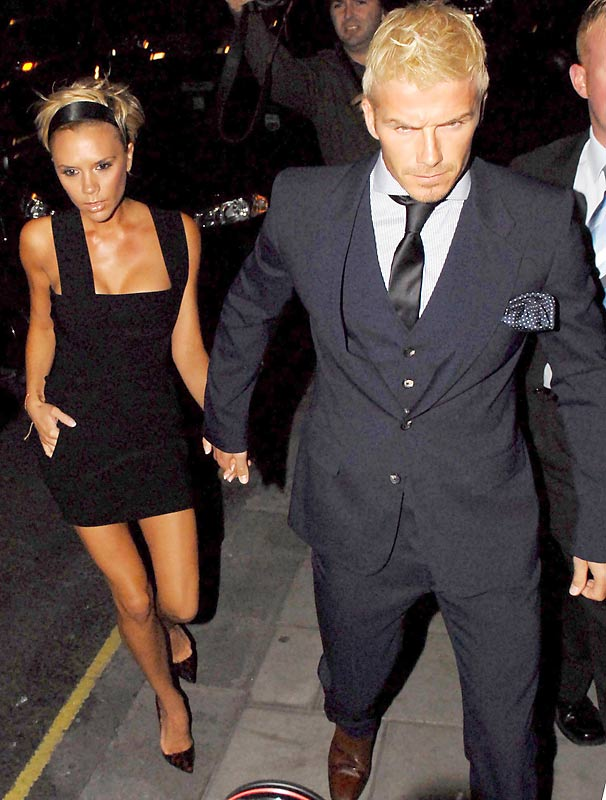 Is David Beckham -- seen here with wife, Victoria, on the way to his 32nd birthday -- unhappy because a) he doesn't like parties or b) he just saw his new hairdo.